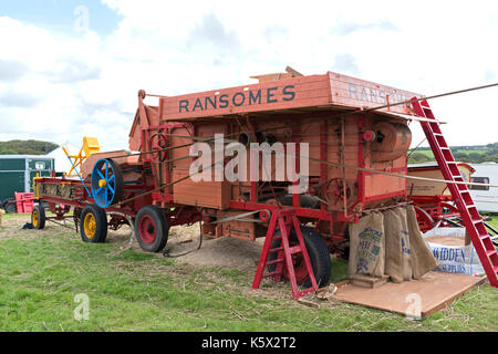 a vintage ransomes threshing machine at a country fayre in cornwall, england, uk. - Stock Photo
