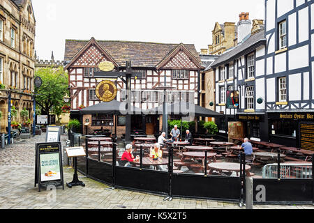 historic old pubs in shambles square, manchester, england, uk. - Stock Photo