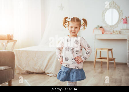 happy face funny baby girl. In a bright room - Stock Photo