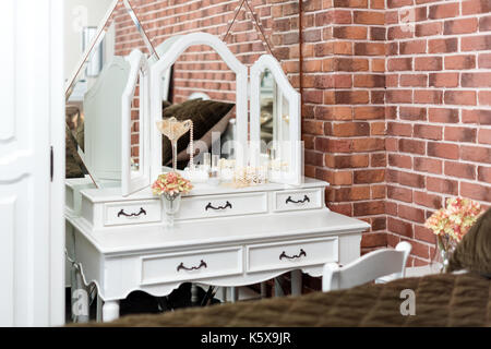 Dressing table in the boudoir. Details of woman bedroom interior. - Stock Photo