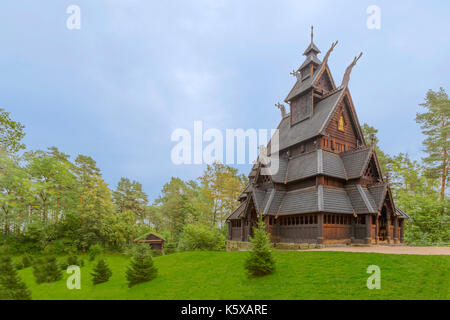 The ancient Stave Church ( Stavkirke ) from Gol in the NORSK FOLKEMUSEUM-  an open air Museum of the Norwegian Cultural - Stock Photo