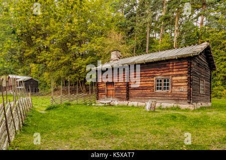 Wooden farmhouse in scenic surroundings in the Norwegian Folk Mueum / NORSK FOLKEMUSEUM, Oslo, Bygdøy, Norway. - Stock Photo