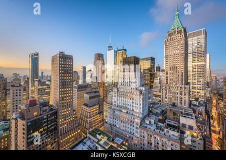 New York City financial district cityscape at twilight. - Stock Photo