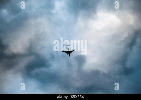 aircraft flying through clouds in overcast bad weather - Stock Photo