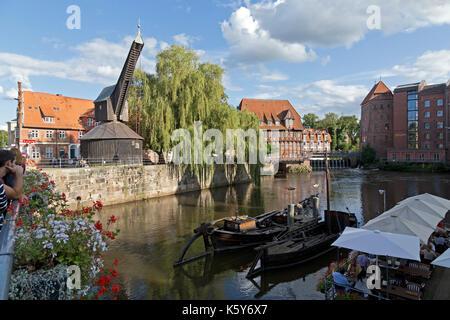 Old Harbour with treadwheel crane and restaurant Luener Muehle, Lueneburg, Lower Saxony, Germany - Stock Photo