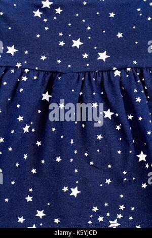 Cute pattern in small white stars. Small white stars seamless pattern. Dark blue background. - Stock Photo
