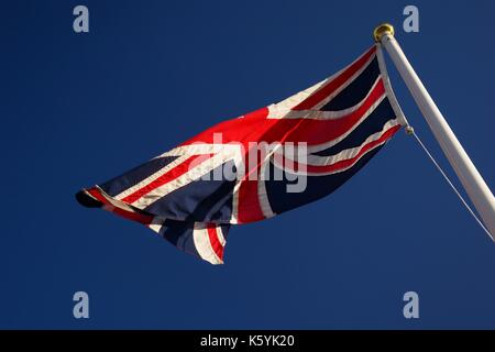 The Union Jack Flag Flying against a Rich Blue Sky. Aberdeen, Scotland. September, 2017. - Stock Photo