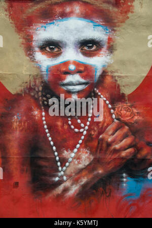 Large street art titled Papua New Guinea by the artist Dale Grimshaw located between Spear and Oldham Street in - Stock Photo