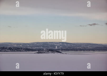 View of iced oslo fjord in winter day in norway - Stock Photo