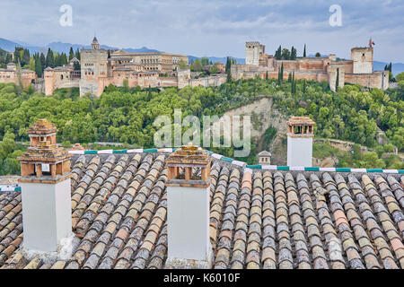 View from Alhambra from the Albaicin neighborhood with houses roofs - Stock Photo