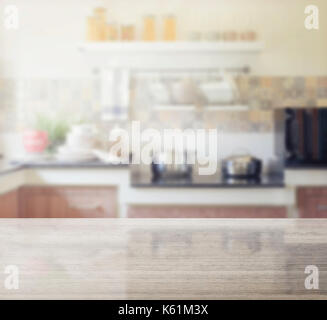 granite table top and blur of modern kitchen interior as background - Stock Photo