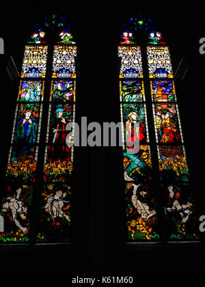 Fribourg, Switzerland - June 26, 2012: Stained Glass Windows created by the Polish painter, Jozef Mehoffer, between - Stock Photo