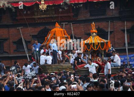 Kathmandu, Nepal. 10th Sep, 2017. People participate in a procession of chariots of Ganesh, Kumari and Bhairav during - Stock Photo