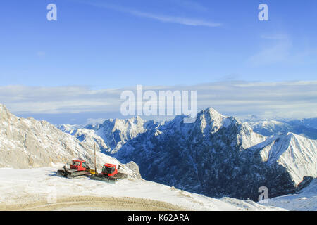 View of a mountain range with snow and clouds - Stock Photo