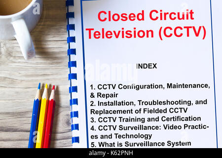 CCTV surveillance security camera concept- with topics on a cover sheet of aa lecture - Stock Photo