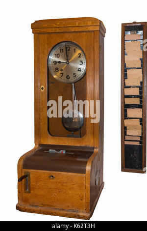 Old Time clock for the recording of working hours. - Stock Photo