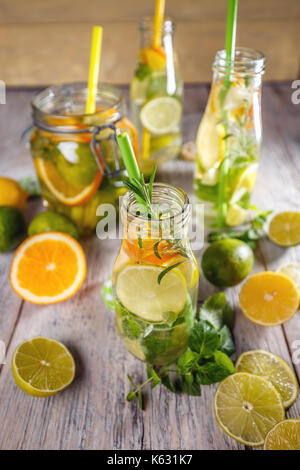 Cold lemon water with fresh fruits in jar - Stock Photo