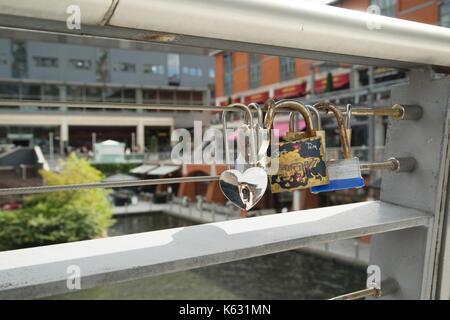 Love locks on a canal bridge in Birmingham, West Midlands, England - Stock Photo