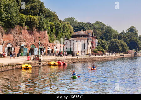 21 June 2017: Exeter, Devon, England, UK - The River Exe at Exeter Quay, with shops and people kayaking on the river. - Stock Photo