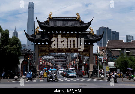 Urban view of Shanghai, China, Asia. Landscape in Chinese city with modern and old buildings, road traffic, cars, - Stock Photo