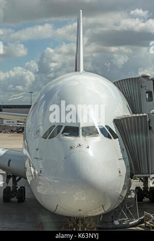 Front view of Air France Airbus A380, F-HPJC, at Paris Charles De Gaulle Airport, France. Shows walkway attached - Stock Photo