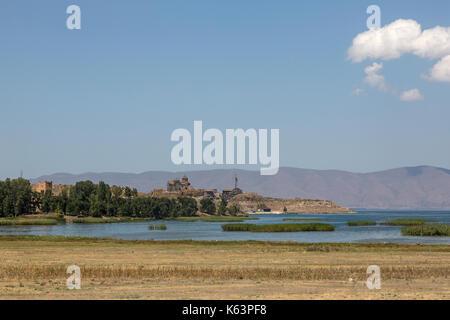View looking across Lake Sevan towards the Sevanavank Monastery in Armenia. - Stock Photo