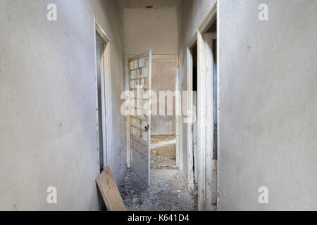 An old and dirty abandoned house - Stock Photo