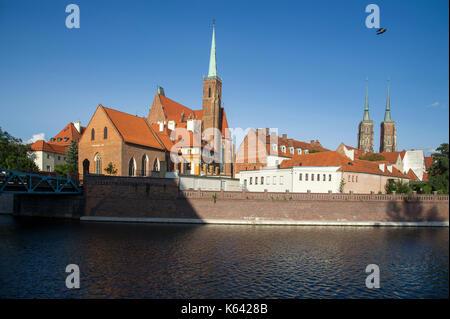 Gothic kolegiata Krzyza Swietego i Sw Bartlomieja (Collegiate Church of the Holy Cross and St. Bartholomew) and - Stock Photo