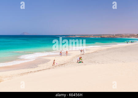 CAPE VERDE SAL Tourists enjoying the emptiness of the white sand and blue sea at Ponta Preta beach near santa maria - Stock Photo