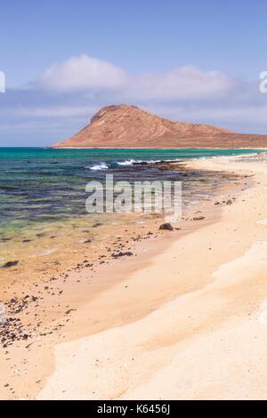 CAPE VERDE SAL Empty sandy beach and bay near Monte Leao mountain (Sleeping Lion mountain), Sal Island, Cape Verde, - Stock Photo