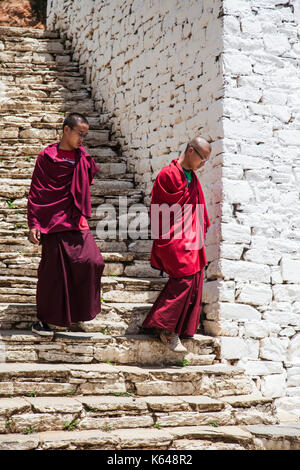 Buddhist monks at holy temple, Bhutan - Stock Photo