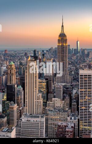 New York City skyline at sunset, aerial view. - Stock Photo