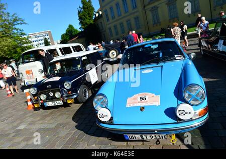 Oldtimers of the type Porsche 911 (l) and British Leyland Mini Van Mark II (r) at the City Grand Prix in Oldenburg - Stock Photo
