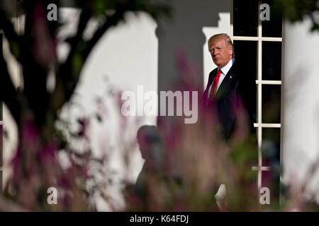 Washington, USA. 11th Sep, 2017. U.S. President Donald Trump walks toward Oval Office of the White House after leading - Stock Photo