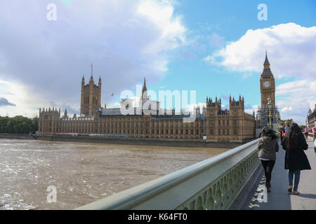 Westminster.London, UK. 11th Sep, 2017. Pedestrians walk on Westminster Bridge on a sunny but blustery day in London - Stock Photo