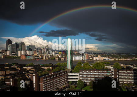 London, UK. 11th Sep, 2017. UK Weather: Rainbow breaks after an afternoon rainstorm over east London including Canary - Stock Photo