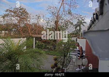 September 11, 2017 - Oakland Park, FL, USA - Mike Kurkuti brings his porch furniture back out of his house on Monday, - Stock Photo