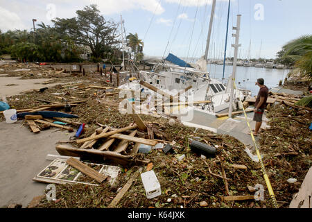 Miami, FL, USA. 11th Sep, 2017. A sailboat crashed and smashed at the Dinner Key Marina in Miami. Mike Stocker, - Stock Photo