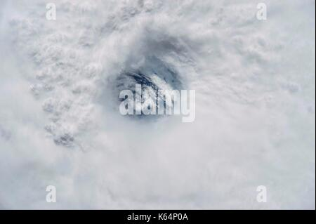 The eye of Hurricane Jose over the Atlantic Ocean above the Leeward Islands with a view straight through to the - Stock Photo