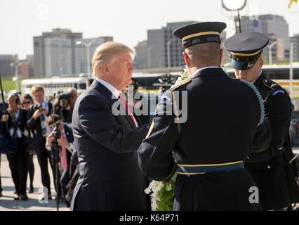 Arlington, United States Of America. 11th Sep, 2014. U.S President Donald Trump places a wreath at the Pentagon - Stock Photo