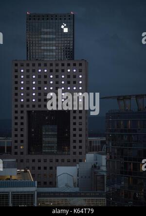 Frankfurt, Germany. 12th Sep, 2017. Illuminated windows shape the logo of the Internationale Automobil-Ausstellung - Stock Photo