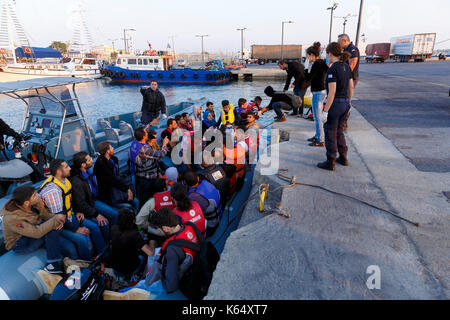 Greece, island of Kos, on 2015/06/14. Coastguards towing an inflatable boat with migrants, mainly from Syria arriving - Stock Photo