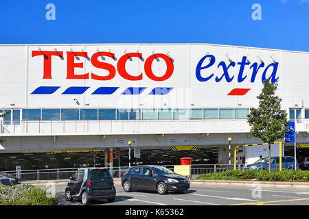 Shoppers In A Tesco Supermarket Uk Stock Photo Royalty