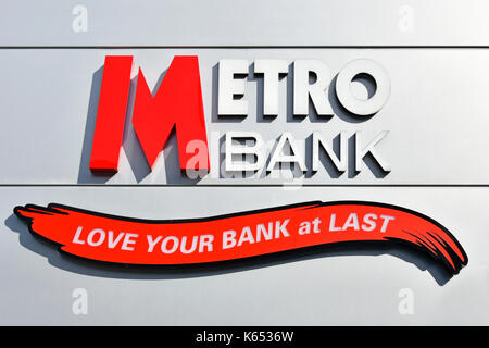 Metro Bank logo and slogan love your bank on wall of new banking branch building in Romford Havering East London - Stock Photo
