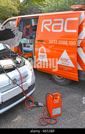 Close up of diagnostic computer equipment connected direct to car by RAC mechanic with RAC breakdown van parked - Stock Photo