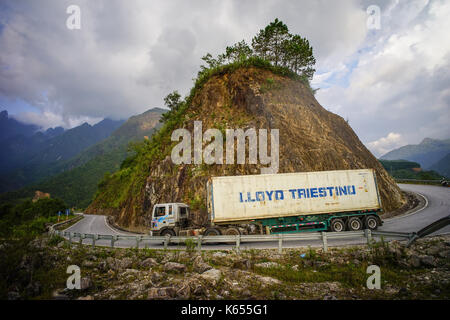 Mai Chau, Vietnam - Sep 28, 2016. A heavy truck running on mountain road in Mai Chau Town, Vietnam. Mai Chau is - Stock Photo