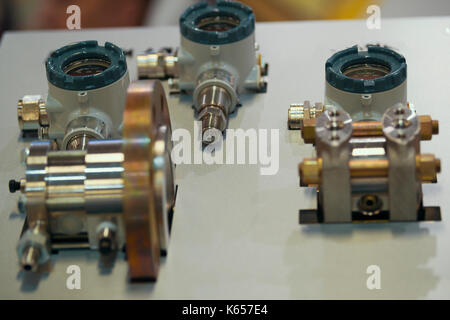 Industrial equipment on technology exhibition - parts of extrusion line - Stock Photo