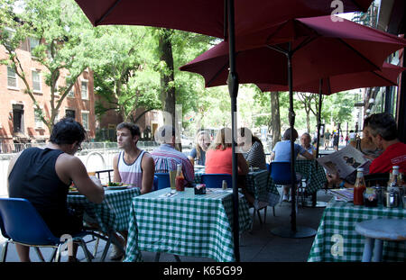 People eating at Diner on Hudson Street in Greenwich Village in NY - USA - Stock Photo