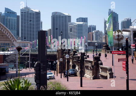Sydney Australia City Skyline At Darling Harbour Flags On Pyrmont Bridge Entrance To Australian National Maritime - Stock Photo