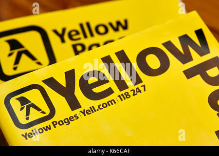 yellow pages classified telephone directory paper edition uk - Stock Photo